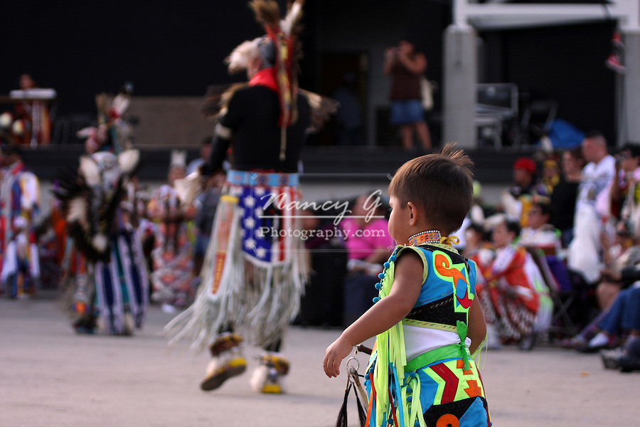 A young Native American Indian boy at a Pow Wow at the Milwaukee Lakefront Indian Summer Festival, Wisconsin watching the other dancers
