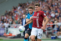 Wes Burns of Fleetwood Town challenges Regan Poole of Northampton Town during the Sky Bet League 1 match between Northampton Town and Fleetwood Town at Sixfields Stadium, Northampton, England on 12 August 2017. Photo by Alan  Stanford / PRiME Media Images.