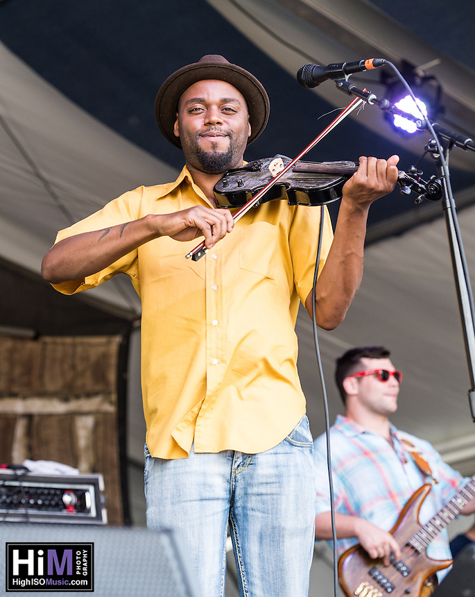 Cedric Watson and Bijou Creole perform at the 2014 Jazz and Heritage Festival in New Orleans, LA.