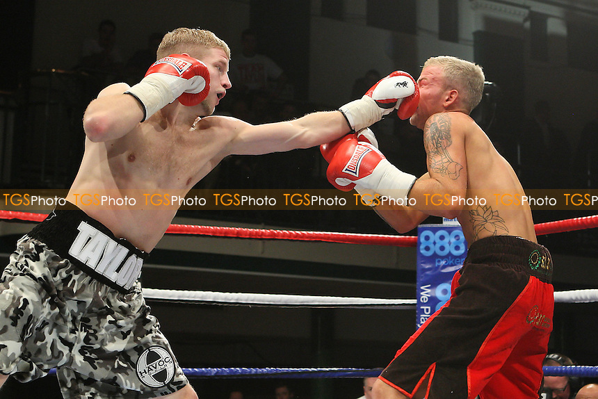 Ryan Taylor (white/black shorts) defeats Robin Deakin in a Lightweight boxing contest at York Hall, Bethnal Green, promoted by Matchroom Sports - 28/01/12 - MANDATORY CREDIT: Gavin Ellis/TGSPHOTO - Self billing applies where appropriate - 0845 094 6026 - contact@tgsphoto.co.uk - NO UNPAID USE.