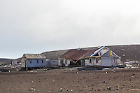 The decaying Bisco House at Whalers Bay on Deception Island. The Bisco House was originally the whalers' bunkhouse when the Norwegian whaling base was in operation. When the British reopened the base in 1944, during WWII, it became a research station.