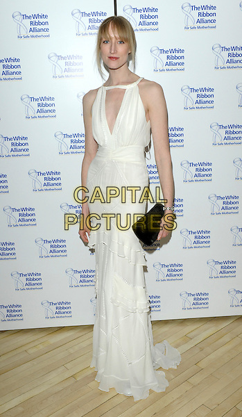 JADE PARFITT .The White Ribbon Alliance's Global Dinner Party Campaign, Agua, Sanderson Hotel, London, England. .March 4, 2010 .full length white sleeveless sheer dress cut out away cleavage black clutch bag layers layered .CAP/CJ.©Chris Joseph/Capital Pictures.
