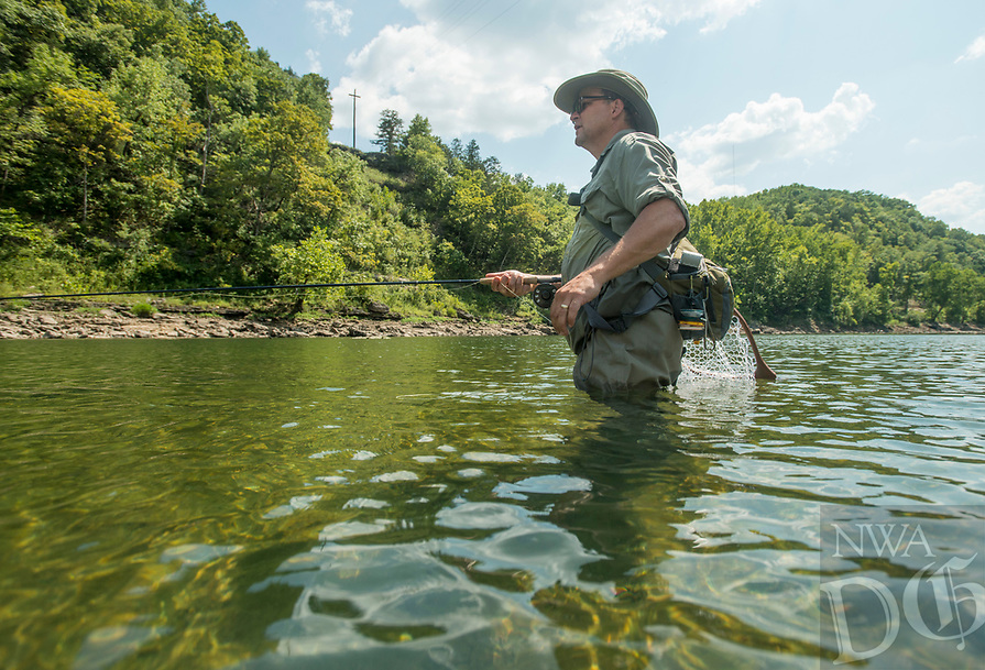 NWA Democrat-Gazette/BEN GOFF @NWABENGOFF<br /> Greg Darling of Carbondale, Ill. casts his line Friday, Aug. 3, 2018, in the White River below Beaver Dam.