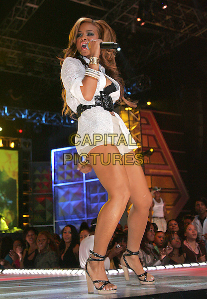 """CHRISTINA MILIAN.At BET's """"Rip the Runway"""" Fashion Show,.New York, NY, USA, 1 March 2006..full length fashion catwalk millian concert live music gig singing high heels white shirt shorts.Ref: ADM/JL.www.capitalpictures.com.sales@capitalpictures.com.© Capital Pictures."""