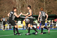 NZ's Andy Hayward (left) congratulates Joel Baker on scoring the second goal during the international hockey match between the New Zealand Black Sticks and Malaysia at Fitzherbert Park, Palmerston North, New Zealand on Sunday, 9 August 2009. Photo: Dave Lintott / lintottphoto.co.nz