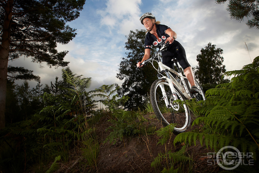 Zoe Spain riding a Specialized mountain bike . Chobham Common , Surrey  .  August   2013.      pic copyright Steve Behr / Stockfile