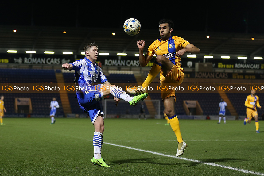 Sean Murray of Colchester United and Malvind Benning of Mansfield Town during Colchester United vs Mansfield Town, Sky Bet EFL League 2 Football at the Weston Homes Community Stadium on 14th March 2017