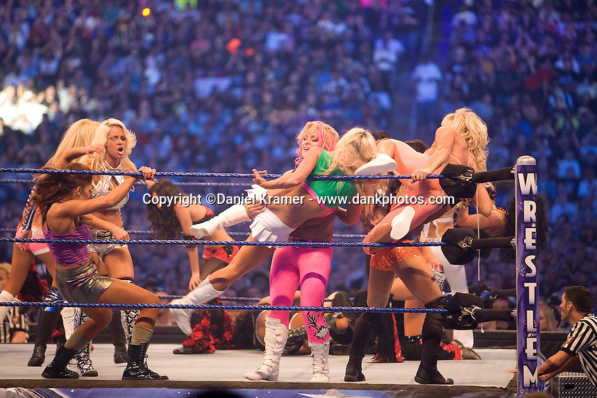 The All-Girl match included one male wrestler in drag at WrestleMania 25 at Reliant Stadium on April 5, 2009 in Houston, Texas.