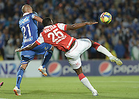 BOGOTÁ -COLOMBIA, 31-08-2014. Juan Esteban Ortiz (Izq.) jugador de Millonarios disputa el balón con Yair Arrechea (Der.) jugador de Independiente Santa Fe durante partido por la fecha 7 de la Liga Postobón II 2014 jugado en el estadio Nemesio Camacho el Campín de la ciudad de Bogotá./ Juan Esteban Ortiz (L) player of Millonarios fights for the ball with Yair Arrechea (R) player of Independiente Santa Fe during the match for the 7th date of the Postobon League II 2014 played at Nemesio Camacho El Campin stadium in Bogotá city. Photo: VizzorImage/ Gabriel Aponte / Staff
