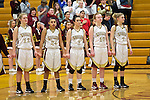 02/08/13--Milwaukie Mustangs starters Emily Downs (12) Taylor Cunningham (24), Lorissa Martine (3), April Meads (10) and Alexis Noren (2) stand hand and hand during the National Anthem before the Mustangs- Liberty Falcons game at Milwaukie High School..Photo by Jaime Valdez..