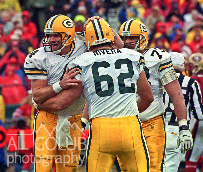 San Francisco 49ers vs. Green Bay Packers at Candlestick Park Sunday, January 11, 1998.  Packers beat 49ers  23-10.  Green Bay Packers quarterback Brett Favre (4) celebrates with guard Marco Rivera (62).