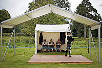 Judges watch and listen to a piper competing in the bagpipe finals at the Inveraray Highland Games, held at Inveraray Castle in Argyll.