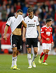 Dejection and frustration for Cameron Carter Vickers of Sheffield Utd and Chris Basham of Sheffield Utd during the Championship match at the City Ground Stadium, Nottingham. Picture date 30th September 2017. Picture credit should read: Simon Bellis/Sportimage