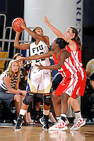 28 January 2012:  FIU guard Jerica Coley (22) is defended by WKU guard Ellen Sholtes (11) and guard Alexis Govan (21) in the first half as the FIU Golden Panthers defeated the Western Kentucky University Hilltoppers, 60-56, at the U.S. Century Bank Arena in Miami, Florida.  Coley, who has scored the second-most points of any women's player in the country, finished the game with 36 points and surpassed the 1,000 point mark.