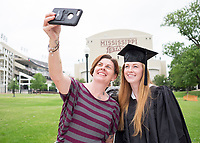 Keats Haupt, a graduating art major from Starkville, and her mom, Shannon Voges-Haupt, pose for a selfie in front of the Bulldog statue in The Junction ahead of Friday and Saturday's [May 5-6] commencement ceremonies at MSU. Haupt is one of nearly 2,900 degree candidates for spring graduation.<br />
