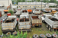 Dump Trucks and tires are part of the industrial landscape along the tracks in Anchorage. The Alaska Railroad's Denali Star train runs between Anchorage and Fairbanks, with Denali one of the stops along the way.