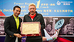 Mission Hills Vice Chairman Tenniel Chu (left) and tennis legend Boris Becker (right) show the newly pressed handprints of Becker's hands during the press conference for the opening of Boris Becker Tennis Academy at Mission Hills Resort on 19 March 2016, in Shenzhen, China. Photo by Lucas Schifres / Power Sport Images