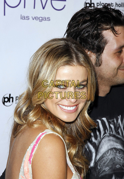 CARMEN ELECTRA & ROB PATTERSON .Carmen Electra hosts at Prive NightClub inside the Planet Hollywood  Hotel and Casino, Las Vegas, Nevada, USA, 12 July 2008..portrait headshot over shoulder back .CAP/ADM/MJT.©MJT/Admedia/Capital Pictures