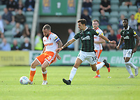 Blackpool's Jay Spearing under pressure from Plymouth Argyle's Ruben Lameiras<br /> <br /> Photographer Kevin Barnes/CameraSport<br /> <br /> The EFL Sky Bet League One - Plymouth Argyle v Blackpool - Saturday 15th September 2018 - Home Park - Plymouth<br /> <br /> World Copyright &copy; 2018 CameraSport. All rights reserved. 43 Linden Ave. Countesthorpe. Leicester. England. LE8 5PG - Tel: +44 (0) 116 277 4147 - admin@camerasport.com - www.camerasport.com