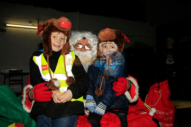 Shane &amp; Stephen Curtis during Santa's visit to Tullyallen  on Monday 8th December 2014.<br /> Picture:  Thos Caffrey / www.newsfile.ie