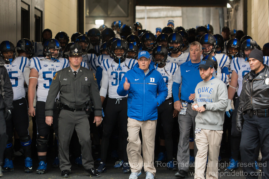 The Duke football team led by head coach David Cutcliffe (blue jacket) take the field. The Pitt Panther defeated the Duke Blue Devils 56-14 at Heinz Field in Pittsburgh, Pennsylvania on November 19, 2016.