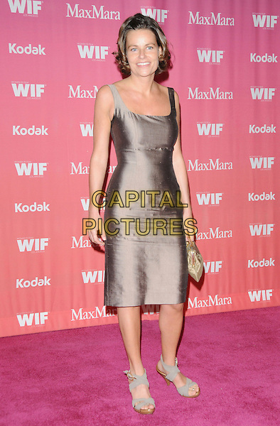 PETRA KORNER .at The Women in Film 2009 Crystal .and Lucy Awards held at The Hyatt Regency Century Plaza in Century City, California, USA, June 12th 2009                                                                     .full length brown grey gray silk dress sleeveless sandals clutch bag gold .CAP/DVS.©Debbie VanStory/RockinExposures/Capital Pictures