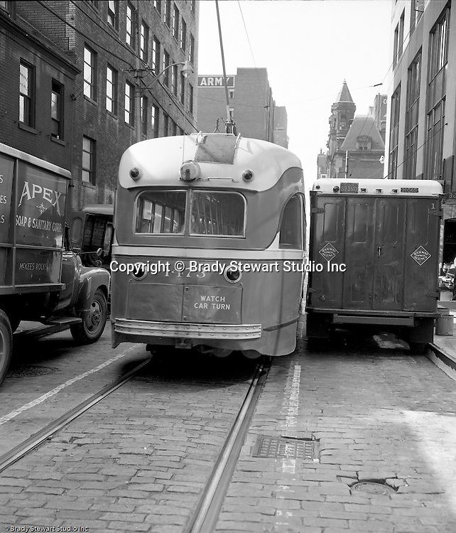 Pittsburgh PA:  View of another accident site for Railway Express in Pittsburgh - 1954.  Accident between two Railway Express vehicles; PCC streetcar and a Railway Express delivery van.  Accident occurred on Forbes Avenue near the Grant Building.