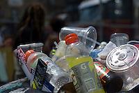 An overflowing trash basket seen in the Bushwick neighborhood in  Brooklyn in New York on Saturday, July 28, 2013.  (© Frances M. Roberts)