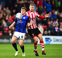 Crewe Alexandra's James Jones shields the ball from Lincoln City's Michael O'Connor<br /> <br /> Photographer Andrew Vaughan/CameraSport<br /> <br /> The EFL Sky Bet League Two - Lincoln City v Crewe Alexandra - Saturday 6th October 2018 - Sincil Bank - Lincoln<br /> <br /> World Copyright &copy; 2018 CameraSport. All rights reserved. 43 Linden Ave. Countesthorpe. Leicester. England. LE8 5PG - Tel: +44 (0) 116 277 4147 - admin@camerasport.com - www.camerasport.com