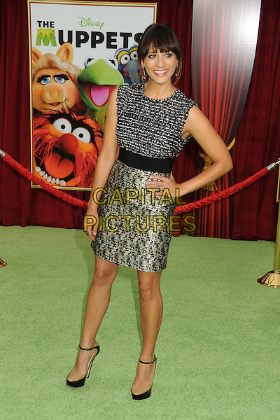 "Rashida Jones.""The Muppets"" Los Angeles Premiere held at the El Capitan Theatre, Hollywood, California, USA..November 12th, 2011.full length grey gray top sleeveless skirt hand on hip silver tweed print .CAP/ADM/BP.©Byron Purvis/AdMedia/Capital Pictures."