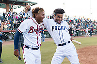 Peoria Javelinas outfielder Cristian Pache (27) and Buddy Reed (85) celebrate winning the Arizona Fall League Championship game against the Salt River Rafters at Scottsdale Stadium on November 17, 2018 in Scottsdale, Arizona. Peoria defeated Salt River 3-2 in 10 innings. (Zachary Lucy/Four Seam Images)