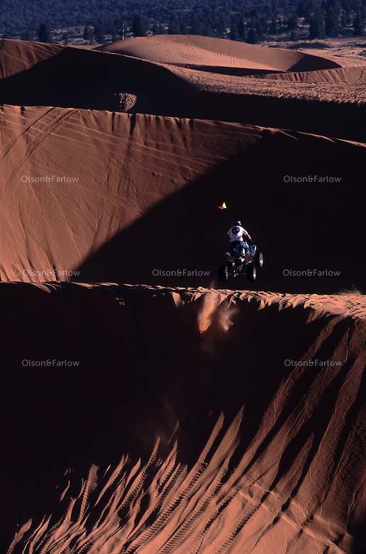 Freewheeling four-wheeler flies over the Coral Pink Sand Dunes of southwestern Utah. Part state park, part BLM wilderness-quality land, the dunes are both playground and battleground. ATVers fight for wide-open access; environmentalists for rare plant and animal species.