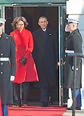 United States President Barack Obama and first lady Michelle Obama arrive to welcome President Francois Hollande of France for a State Visit on the South Lawn of the White House in Washington, D.C. on Tuesday, February 11, 2014.<br /> Credit: Ron Sachs / CNP