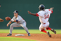 Center fielder Felix Sanchez (34) of the Greenville Drive steals second base as second baseman Tommy La Stella (22) of the Rome Braves takes the throw in the first inning of a game on July 18, 2011, at Fluor Field at the West End in Greenville, South Carolina. Rome beat Greenville, 7-3. (Tom Priddy/Four Seam Images)