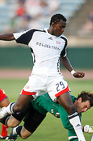 """New England Revolution forward Abdoulie """"Kenny"""" Mansally (29) collides with Crystal Palace goalkeeper Brian Rowland (1). The New England Revolution (MLS) defeated Crystal Palace FC USA of Baltimore (USL2) 5-3 in penalty kicks after finishing regulation and overtime tied at 1-1 during a Lamar Hunt US Open Cup quarterfinal match at Veterans Stadium in New Britain, CT, on July 8, 2008."""