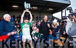 Celebrations begin as Ballydonoghue captain Paul Kennelly holds aloft the NK football championship cup.
