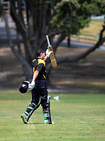 Lauchie Johns celebrates making his century off the last ball of the innings during the Under-19 World Cup warm-up cricket match between Wellington XI and Zimbabwe Under-19s at the Scots College in Wellington, New Zealand on Sunday, 31 December 2017. Photo: Dave Lintott / lintottphoto.co.nz