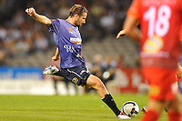 MELBOURNE, AUSTRALIA - JANUARY 23, 2010: Nick Ward from Melbourne Victory kicks for goal in round 24 of the A-league match between Melbourne Victory and Adelaide United FC at Etihad Stadium on January 23, 2010 in Melbourne, Australia. Photo Sydney Low www.syd-low.com