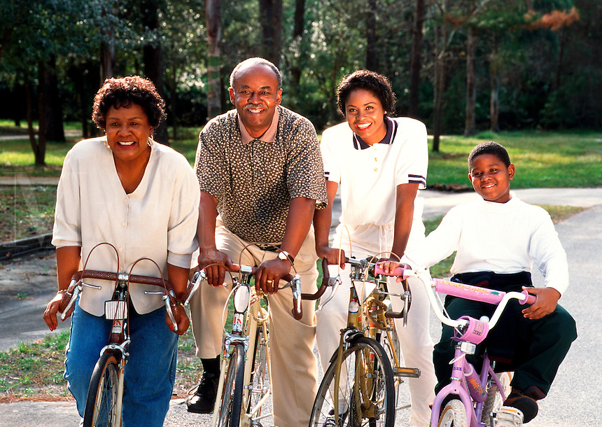 Multigenerational black family on bicycles