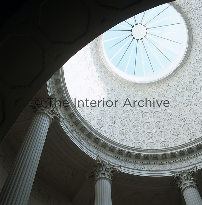 View up into the dome of the central rotunda with its ornamental plaster ceiling