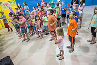 NWA Democrat-Gazette/ANTHONY REYES &bull; @NWATONYR<br /> Children sing songs before the start of bible school Monday June 22, 2015 during the &ldquo;Vacation Bible School Xtreme&quot;  at Robinson Avenue Church of Christ in Springdale. The theme of the program is building each other up and the night's focus was on using words to do that.