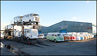 BNPS.co.uk (01202 558833)<br /> Pic: LauraJones/BNPS<br /> <br /> Another transporter unloads the last ever VW campervans to Danbury MotorCaravans in Yate, Bristol.<br /> <br /> The last ever delivery of brand new Volkswagen campervans has arrived in Britain marking the end of an era for the iconic 'hippy bus'.<br /> <br /> Ninety nine of the final batch of vans rolled off the production line and onto a container ship bound for British shores after manufacture ceased for good in Brazil in December.<br /> <br /> And though the consignment has only just arrived, almost all of the vans have already been snapped up by eager buyers happy to fork out the &pound;35,000 starting price.<br /> <br /> They are the last brand new campers in all of Europe.