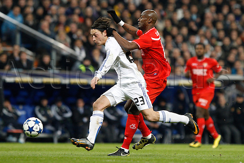 02.02.2011 Spanish Copa del Rey from the Santiago Bernebeu. Real Madrid vs Sevilla 2-0. Picture shows  (L) Ozil and Zokora (R) in action during the match.......