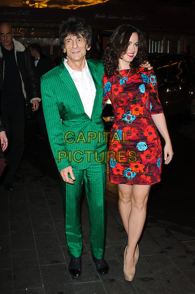 Ronnie Wood & Sally Humphreys.The British Fashion Awards 2012, Savoy Hotel, The Strand, London, England..November 27th, 2012.full length green suit white shirt red maroon burgundy floral print dress pinstripe couple .CAP/CJ.©Chris Joseph/Capital Pictures.