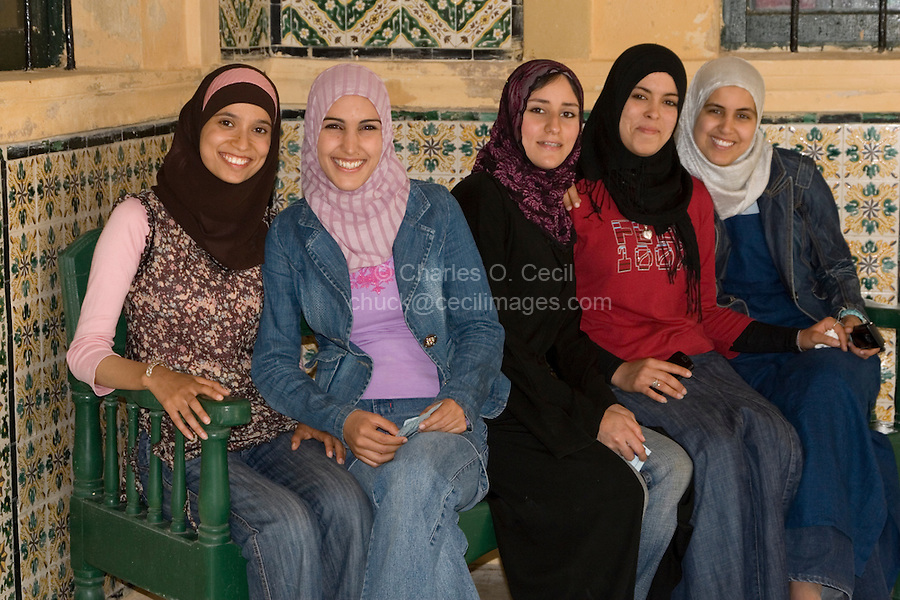 Tripoli, Libya - Young Libyan Women.  These women have adopted western European or American clothing styles while maintaining the Libyan custom of covering the hair with a scarf.