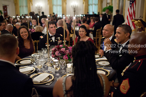 United States President Barack Obama talks with members of the military and guests during a Department of Defense dinner in the East Room of the White House, February 29, 2012. The President and First Lady hosted the dinner to honor members of the Armed Forces who served in Operation Iraqi Freedom and Operation New Dawn, and to honor their families.  .Mandatory Credit: Pete Souza - White House via CNP
