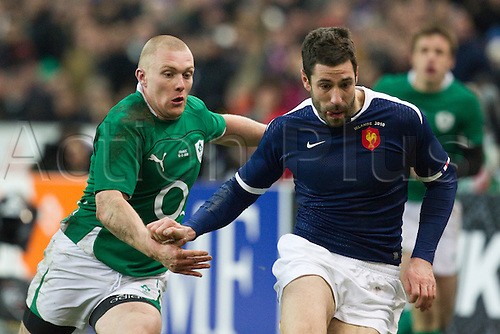 13 Februray 2010: Julien Malzieu of France runs for the ball against Paddy Wallace of Ireland during the six nations match won 33-10 by France over Ireland at the Stade de France stadium in Saint-Denis, near Paris, France..Photo: Christophe Elise/ACTIONPLUS- EDITORIAL USE ONLY