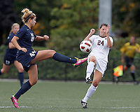 Yale University midfielder Muriel Battaglia (44) passes the ball as Harvard University forward Elizabeth Weisman (24) closes. In overtime, Harvard University defeated Yale University,1-0, at Soldiers Field Soccer Stadium, on September 29, 2012.