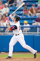 Anthony Rizzo #25 of the Salem Red Sox follows through on his swing against the Kinston Indians at Lewis-Gale Field May 1, 2010, in Winston-Salem, North Carolina.  Photo by Brian Westerholt / Four Seam Images