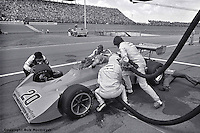 Gordon Johncock makes a pit stop for fuel and tires enroute to winning a 1976 USAC race at Michigan International Speedway near Brooklyn, Michigan, USA.
